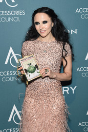 Stacey Bendet showed off a cute printed box clutch by Alice + Olivia at the 2018 ACE Awards.