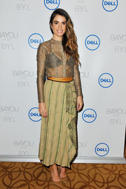 Nikki Reed wore a sheer gold blouse by Sophie Theallet at the launch of her jewelry collaboration with Dell.