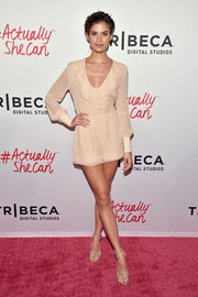 Sara Sampaio's gorgeous legs were the star of the show when she wore this nude ruffle romper to the #ActuallySheCan Short Film Series release.
