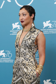Ruth Negga blinged up with layers of gold bracelets by Beladora for the 'Ad Astra' photocall during the Venice Film Festival.