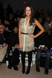 Erin looked like a stud at the Adam fashion show in a beige studded cocktail dress and opaque black tights.