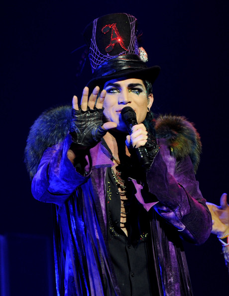 Adam sports some edgy fingerless gloves for his on stage ensemble.