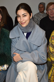 Caroline Issa accessorized with a gray and blue fur scarf for added warmth to her wool coat at the Adam Selman Fall 2015 show.