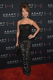 Susan Lucci kept the sassy vibe going with a pair of semi-sheer, metallic-embroidered pants.