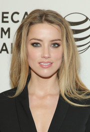 Amber Heard attended the 'Adderall Diaries' premiere wearing a punky center-parted hairstyle.