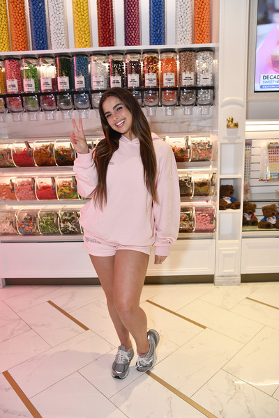 Addison Rae kept it super casual in a pink hoodie while celebrating her brother's birthday at Sugar Factory.