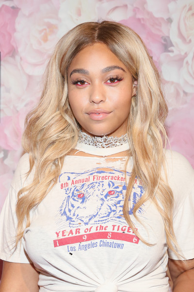 Jordyn Woods' sparkling choker added a touch of glamour to her torn tee.
