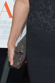 Gloria Reuben added some sparkle to her red carpet look with this silver beaded clutch.