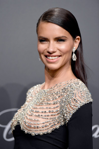 Adriana Lima Long Straight Cut [hair,face,hairstyle,shoulder,eyebrow,beauty,lip,chin,dress,fashion,caroline scheufele,adriana lima,rihanna,chopard space party - photocall,cannes,france,port canto,chopard space party,chopard,cannes film festival]