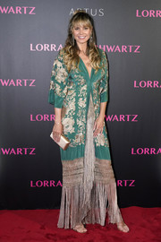 Heidi Klum donned a fringed and embroidered maxi dress by Johanna Ortiz for the Lorraine Schwartz party in Hong Kong.