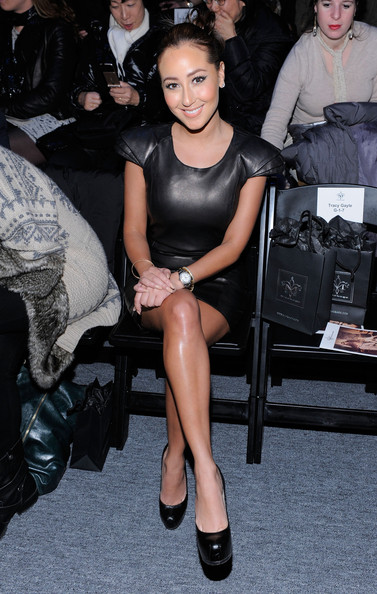 Singer Adrienne Bailon attends the Mackage Fall 2011 fashion show during