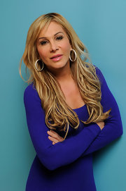 Adrienne Maloof complemented her simple outfit with a huge pair of diamond hoops for her portrait at the 2011 Sundance Film Festival.