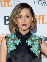 Rose Byrne topped off her look with a bold berry lip.