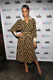 Tyra hit an event in New York in a striped long sleeve day dress, which she paired with Louboutin Maggie pumps.