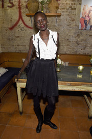 Alek Wek's knee-high boots added a touch of edge.
