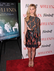 Nicola Peltz looked bold on the red carpet in an asymmetrical print blouse by Louis Vuitton during the 'Affluenza' premiere.