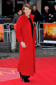 Kate Silverton updated a classic ankle-length wool coat by opting for a cherry-hued version as she attended the UK premiere of 'African Cats.'