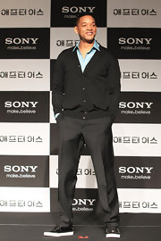 Will Smith chose a pair of crisp slacks for his look while at the 'After Earth' press conference in Seoul.