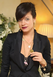 Lily Allen put a dark spin on her look with a glamorous shade of burgundy lipstick.