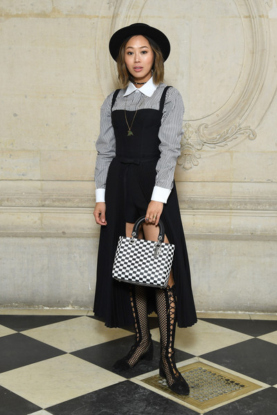 Aimee Song Lace Up Boots [clothing,street fashion,black-and-white,fashion,tights,snapshot,monochrome photography,neck,footwear,dress,christian dior,aimee song,part,paris,france,paris fashion week womenswear fall,photocall - paris fashion week womenswear fall]