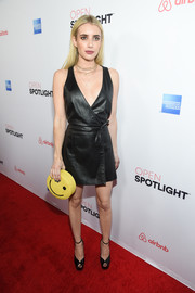 Emma Roberts was rocker-chic in a black leather wrap dress at the Airbnb Open Spotlight event.