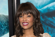 Aisha Tyler Medium Wavy Cut with Bangs
