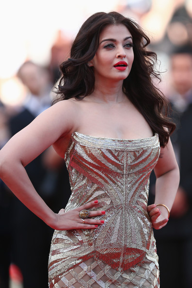 Aishwarya Rai Statement Ring [one night,two days one night,clothing,dress,fashion model,shoulder,strapless dress,lady,red,fashion,beauty,premiere,aishwarya rai,premieres,cannes,france,premiere,cannes film festival]
