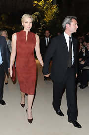 Charlene looked sophisticated in this burnt orange leather dress front row at the Akris show Paris Fashion Week.