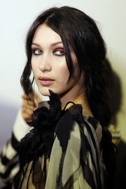 Bella Hadid looked goth with her smoky red and black eyeshadow at the Alberta Ferretti fashion show.