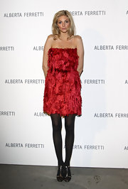 Tamsin Egerton had her legs covered up with black tights at the Alberta Ferretti dinner gala.
