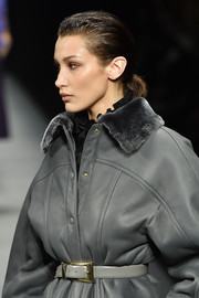 Bella Hadid walked the Alberta Ferretti runway wearing a gray leather jacket and belt combo.