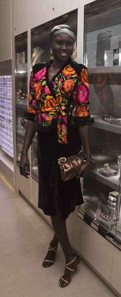 Alek Wek Metallic Clutch