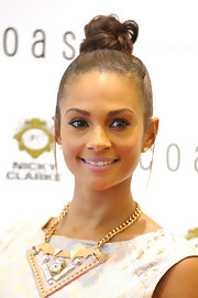 Alesha Dixon finished off her look with a fun top-knot when she attended the launch of Coast's new flagship store.