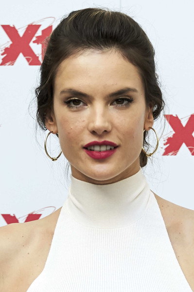 Alessandra Ambrosio styled her hair into a casual chignon for the Xti presentation.