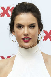 Alessandra Ambrosio paired her 'do with classic gold hoops.