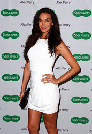 Megan Gale sported a simple yet cool little white dress with horizontal ruching on the bodice when she attended the Alex Perry eyewear launch.