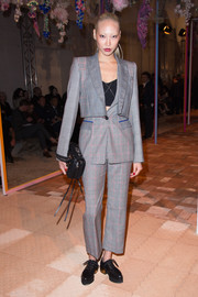 Soo Joo Park teamed her suit with black leather lace-ups.