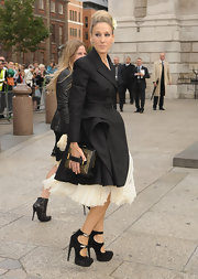 Sarah Jessica Parker showed off her fashion flair while hitting the Alexander McQueen memorial. She paired her ensemble with a cool box clutch.