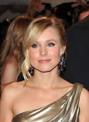Kristen Bell styled her hair in a loose bun at the 2011 Met Gala. The actress let her side parted bangs frame her face.