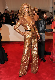 Iman added a golden touch to her sequin jumpsuit with a 19th Century gold Gothic Revival belt buckle.