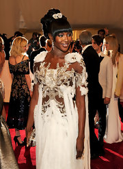 Naomi Campbell rocked a high-volume twisted bun at the 2011 Met Gala. She topped her look off with a sparkling brooch.