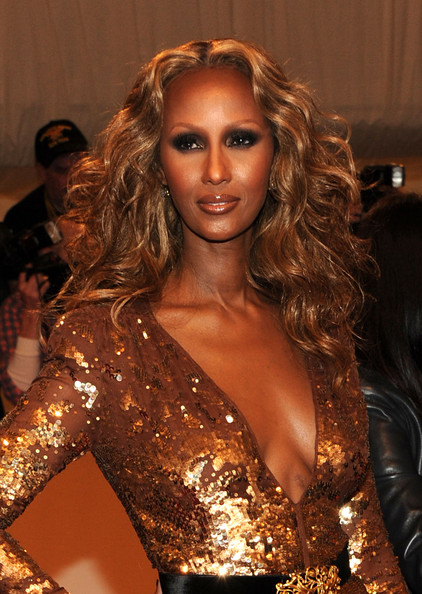 Iman shimmied down the red carpet at the 2011 Met Gala with honey-hued curls parted down the center.