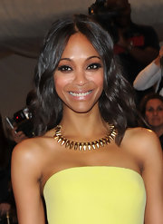 Zoe Saldana highlighted her yellow dress with a gold bullet necklace that fit securely across her collar.