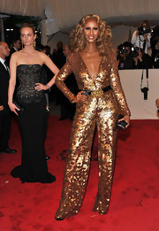 Iman accessorized her glittery red carpet ensemble with the large 'Collins' clutch.