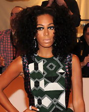 Solange added a unique touch to her look with futuristic looking eyeshadow that was precisely rimmed around her upper lid.