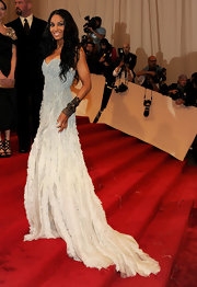 Ciara graced the red carpet at the 2011 Met Gala in a strapless two-toned blue-and-white gown. The singer teamed her glamorous look with an arm full of bangle bracelets and long center part curls.