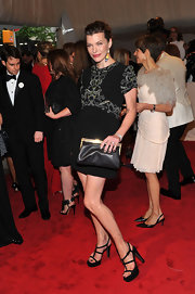 Milla Jovovich wore a black Marni mini dress with embellished shoulders to the 2011 Met Gala.