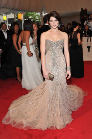 Ashley Greene accented her fairy tale gown with a metallic gold box clutch.
