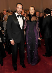 Carolyn looked romantic in a purple and black lace evening gown for the Met Gala.