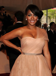 La La was a modern day princess in a sheer blush gown. She paired her elegant look with a side swept chignon.